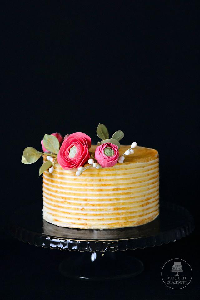 gold cake with sugar flowers