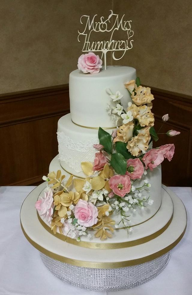 Wedding cake with Roses Lisianthus and Gladioli .