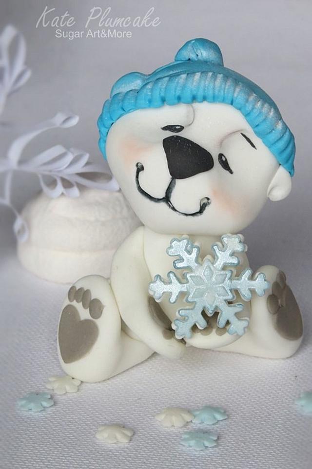 Polar bear cub with snow flake