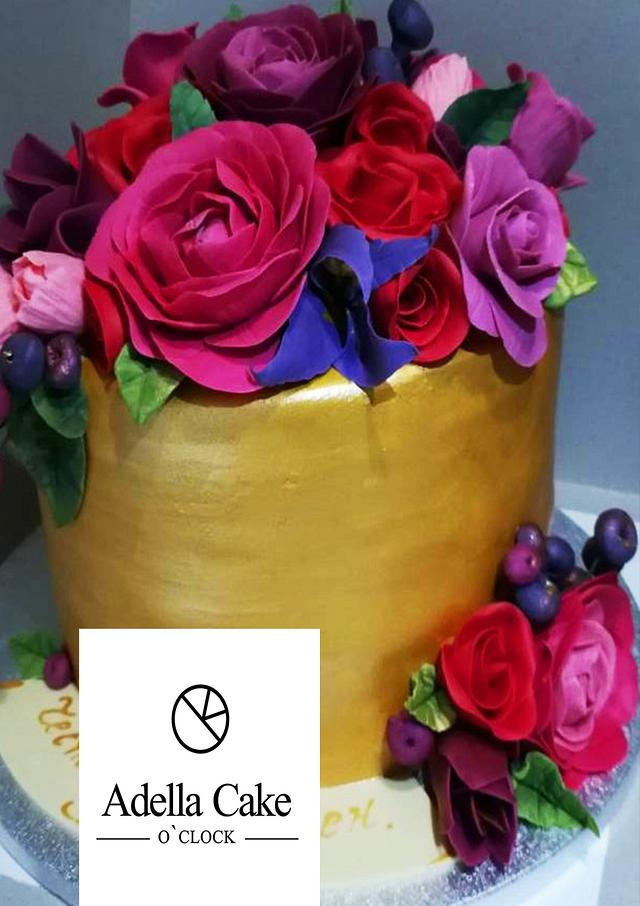golden cake with sugar flowers