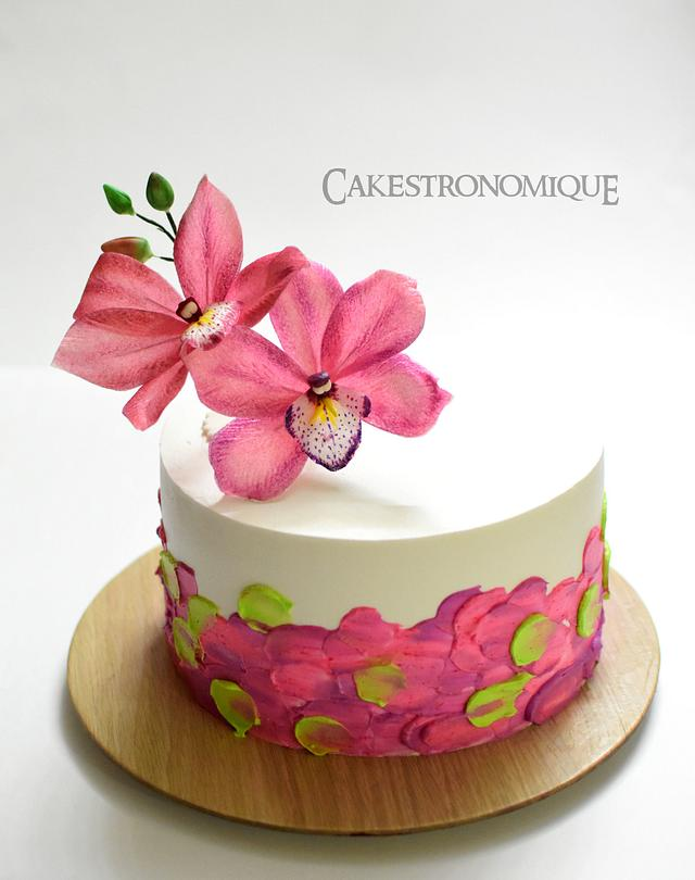 Edible wafer paper Cymbidium Orchid adorned whipped cream frosted cake