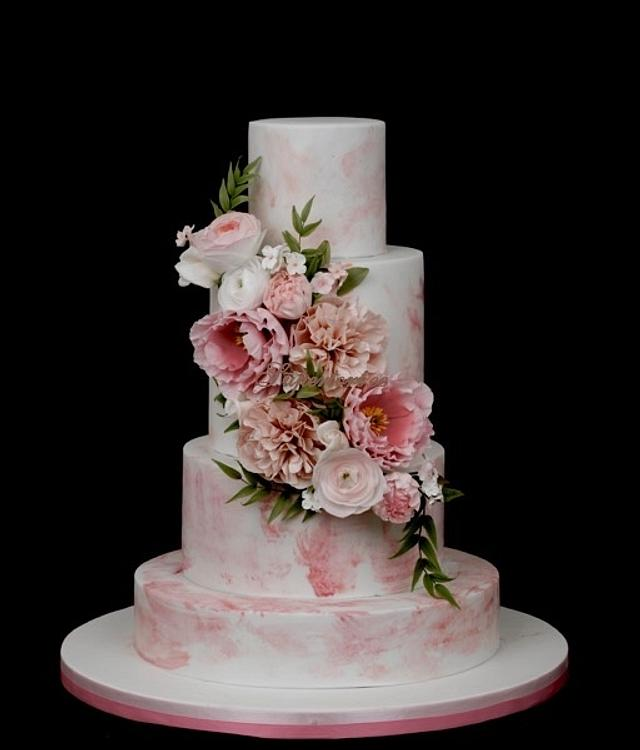 Pink watercolor effect cake with sugarflowers