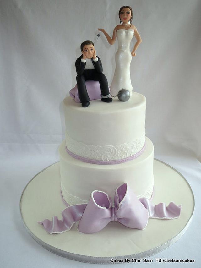 Lilac wedding cake with novelty sugar paste couple