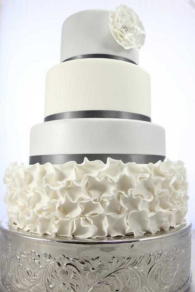 Silver and white ruffle wedding cake