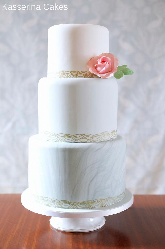 Ombre wedding cake with marbled bottom tier
