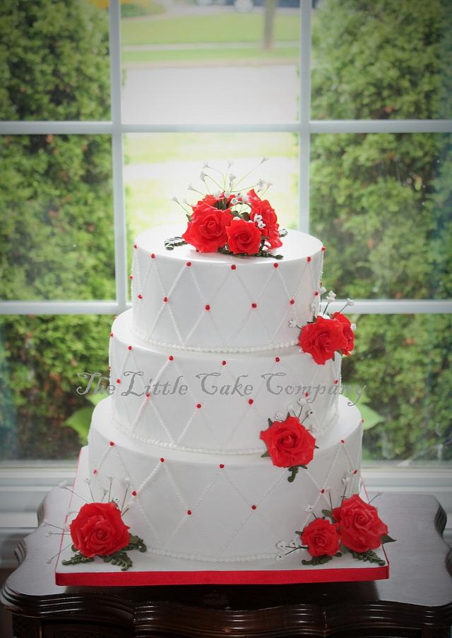 white and red wedding cake