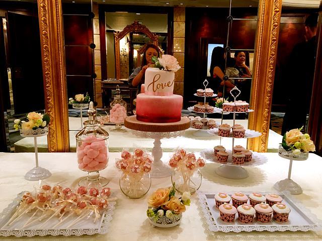 Pink Theme Wedding cake and candy corner