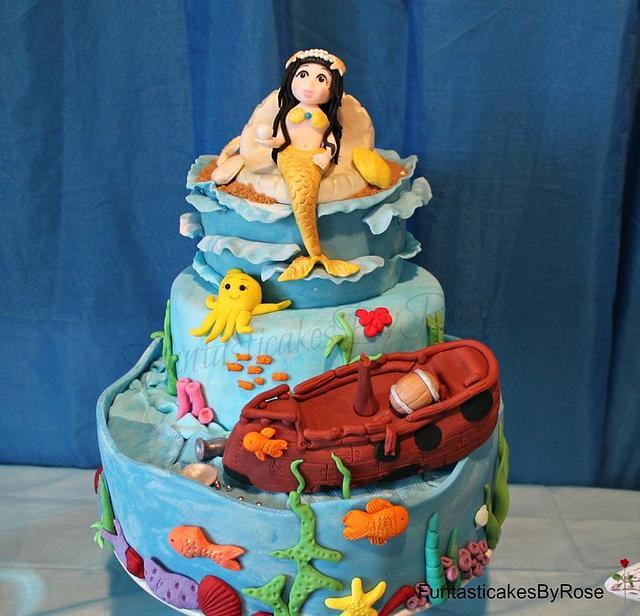 Under the sea mermaid and sunken pirate ship  cake