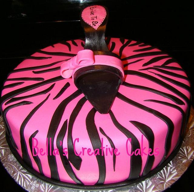 Zebra cake and pink shoe