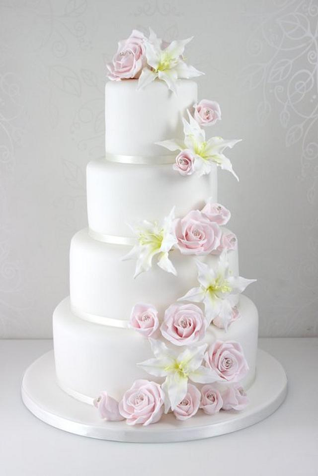 Rose and lily cascade wedding cake