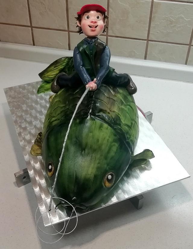 Fisherman a his carp