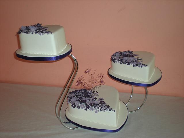 Purple blossom wedding cake