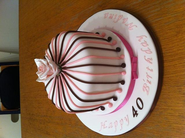stripy cake with rose topper