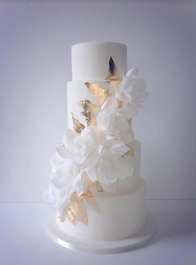 Cascading wafer paper roses and gold leaf wedding cake