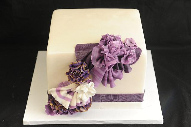 Purple Ruffles and Straight  Sparp Edges  Fondant Finish Butter Cream Under Coat