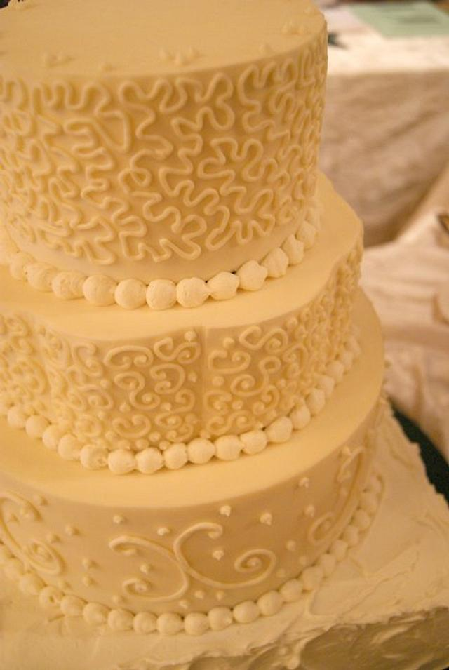 Multi-shape, multi-swirl wedding cake