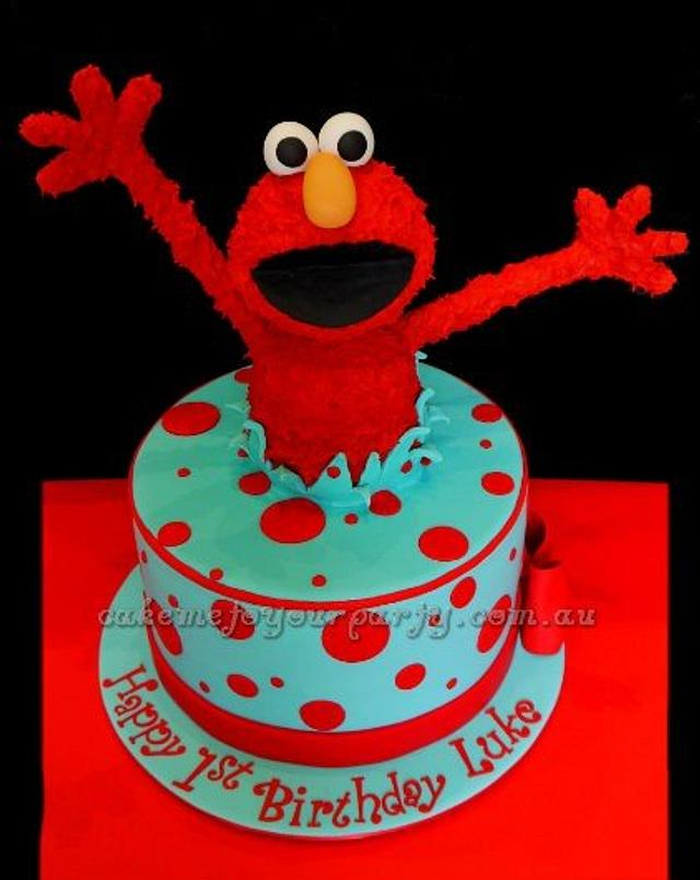 Elmo Jumping Out Of The Cake