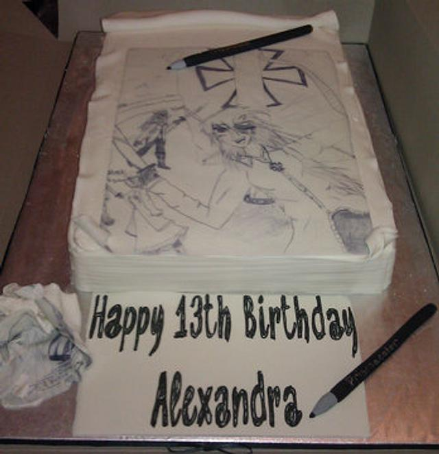 Sketch pad cake with drawing pencils and crumpled piece of paper