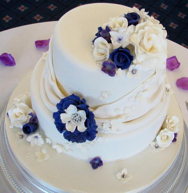 Sumptuous cream and cadbury purple wedding cake