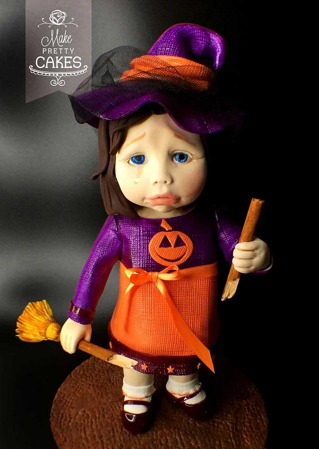 Sweet little witch has broken her broom.  Will she ever fly again?
