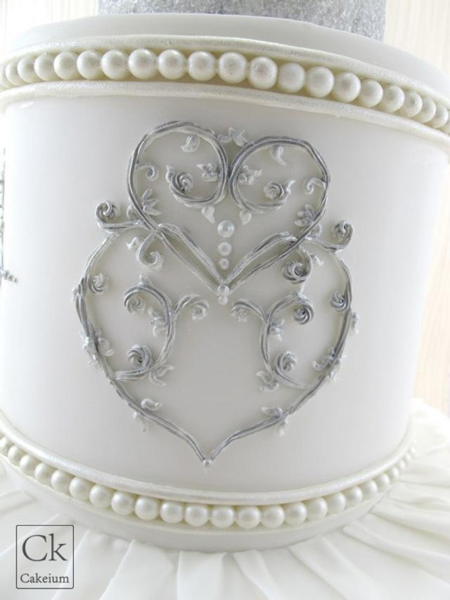 Ruffled, piped and shimmered Wedding Cake