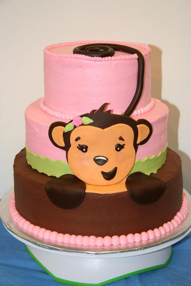 Girl monkey baby shower cake