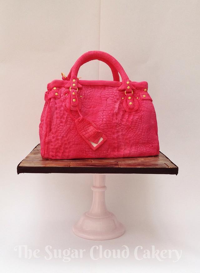 Pink alligator skin handbag