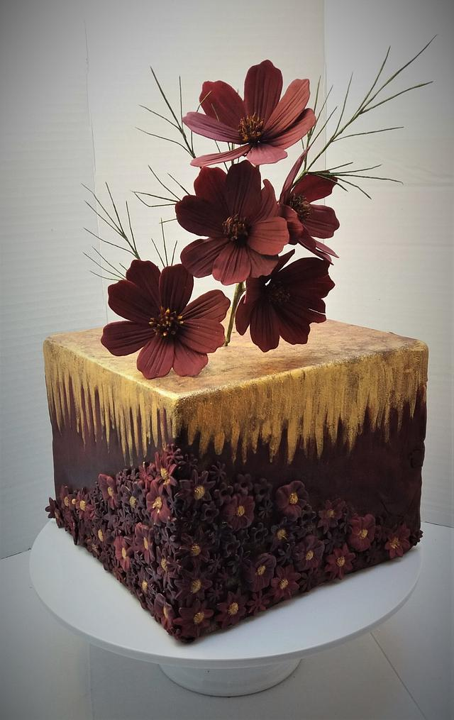 Cake with chocolate cosmos flowers