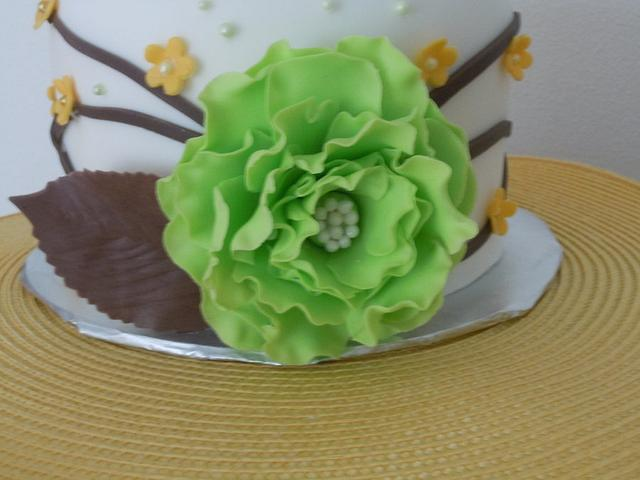 Green, brown, and yellow wedding cake sample
