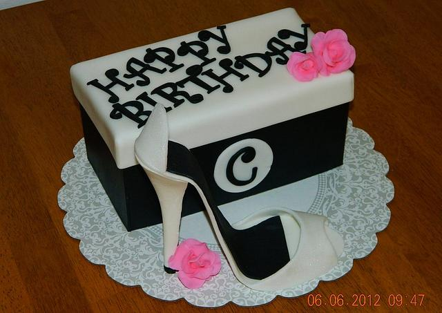 Shoe box cake w/gum paste shoe and flowers.