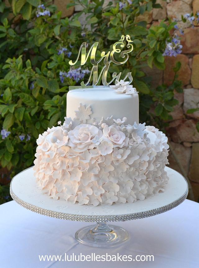 Pastel pink and grey wedding cake