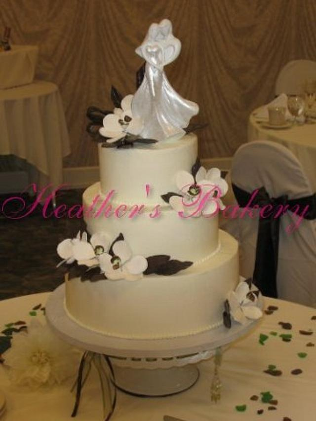 Buttercream with Gumpaste Flowers and Chocolate Leaves and Ribbon