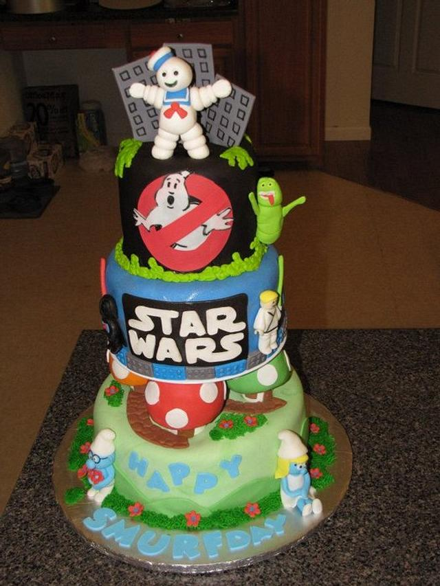 Ghost busters , lego star wars  and Smurfs multi-theme cake