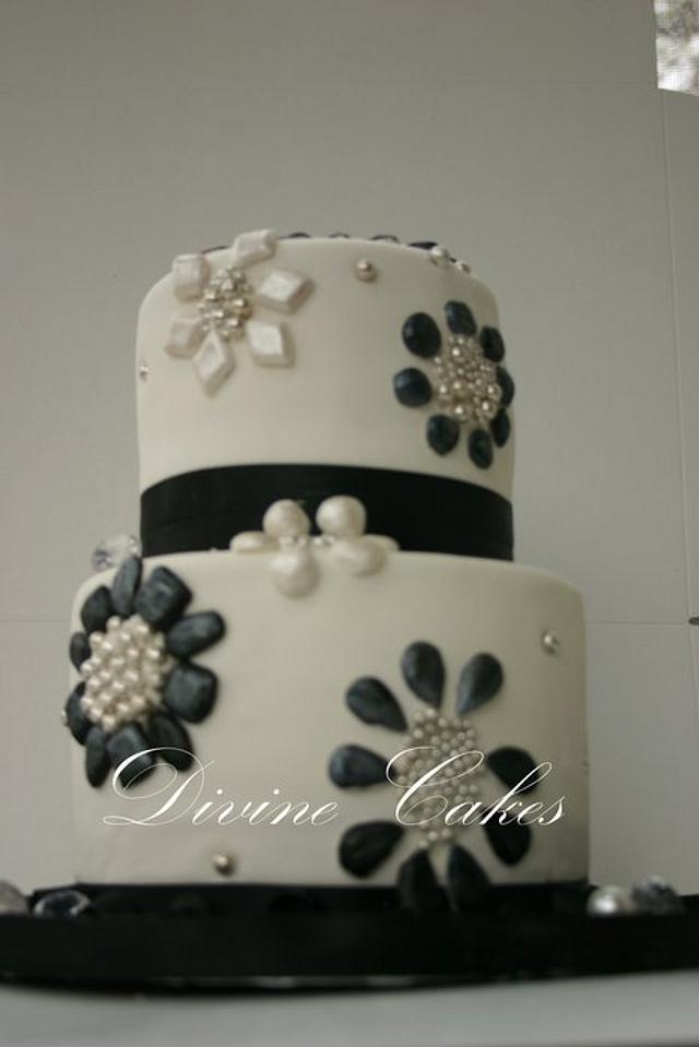 A 2 Tier Black andwhite Bejewled Cake..
