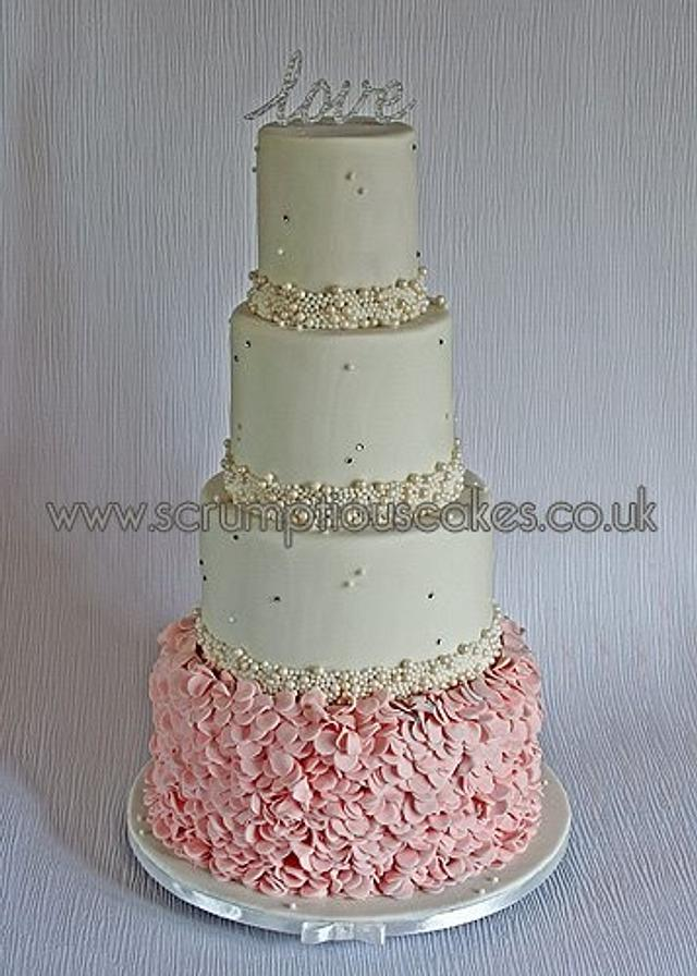 Blush Pink Ruffles and Ivory Pearls Weddng Cake