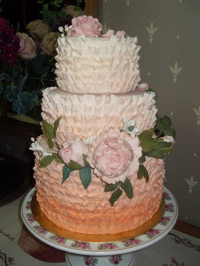 Ombre ruffle wedding cake with sugar paste peonies and roses