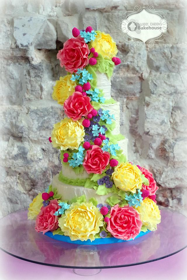 rustic buttercream wedding cake with sugar peonies, roses, billy balls and filler flowers