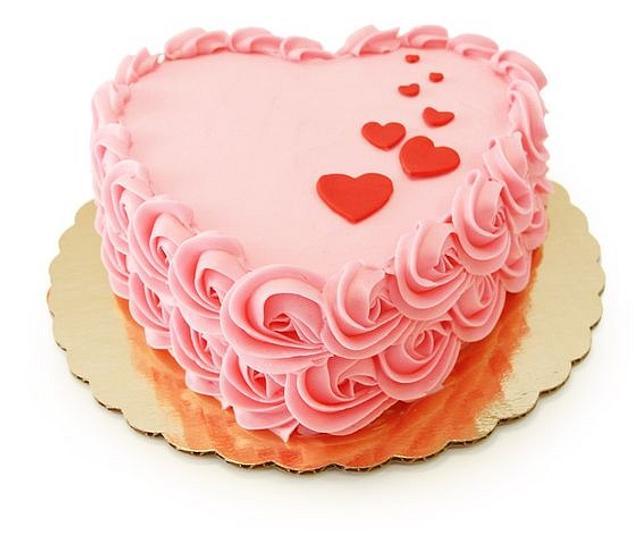 Torta en forma de corazón con rosetones