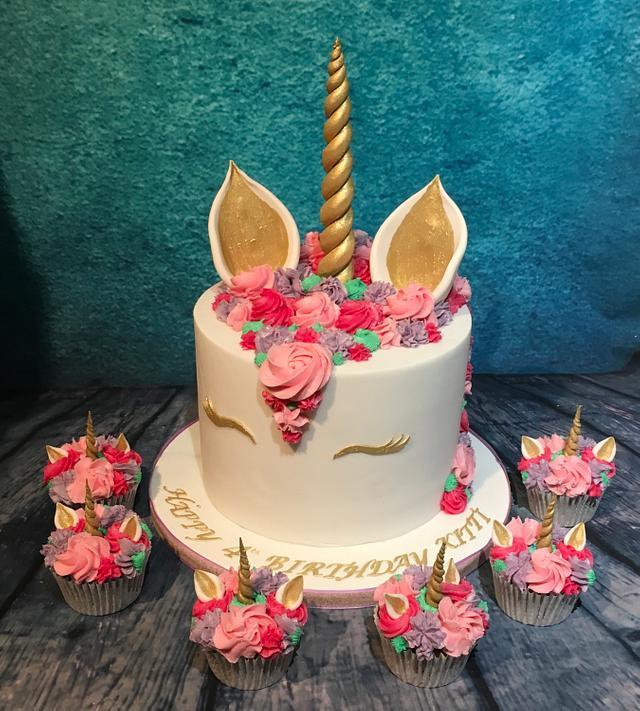 Pink unicorn cake and cupcakes