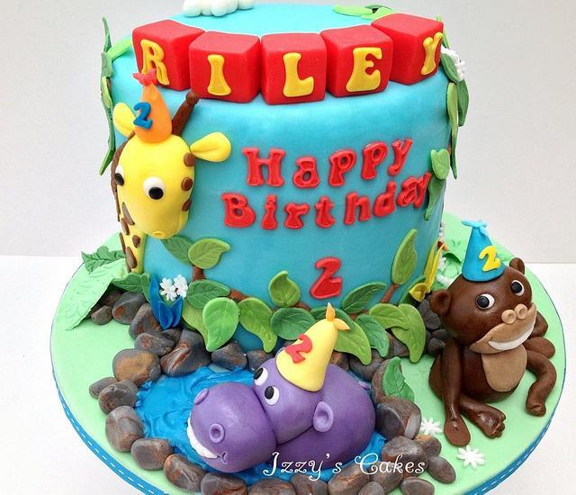Jungle rainbow birthday cake