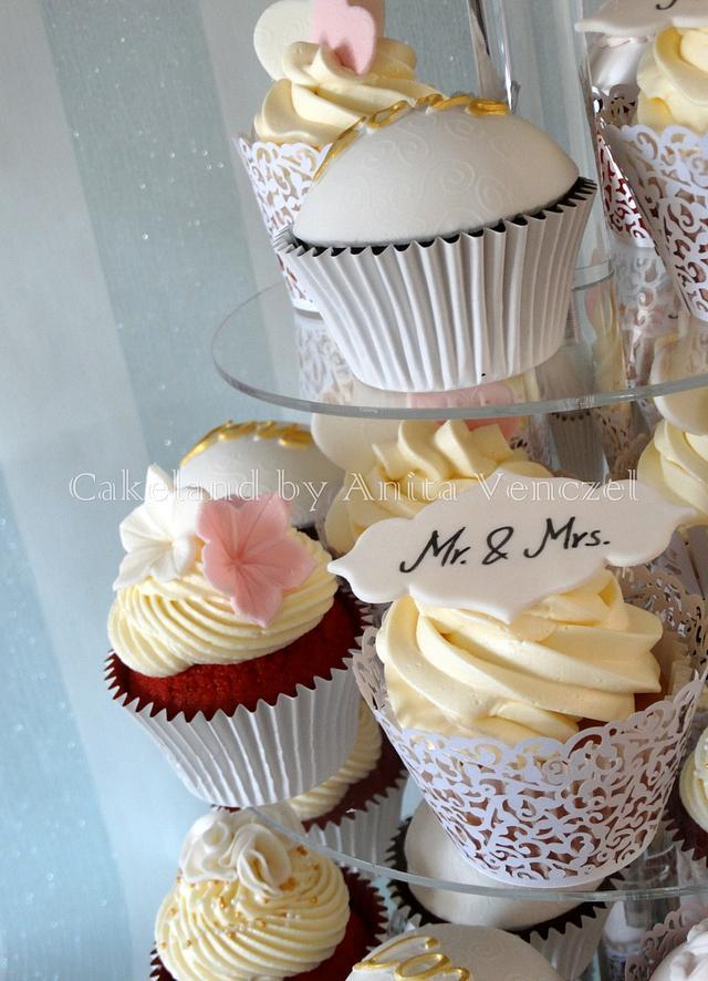 Romantic wedding cake with cupcakes