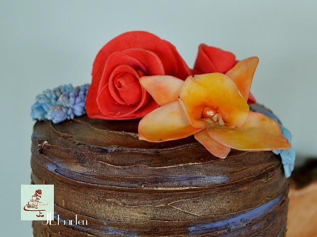 colorful chocolate weddingcake with chocolate lace