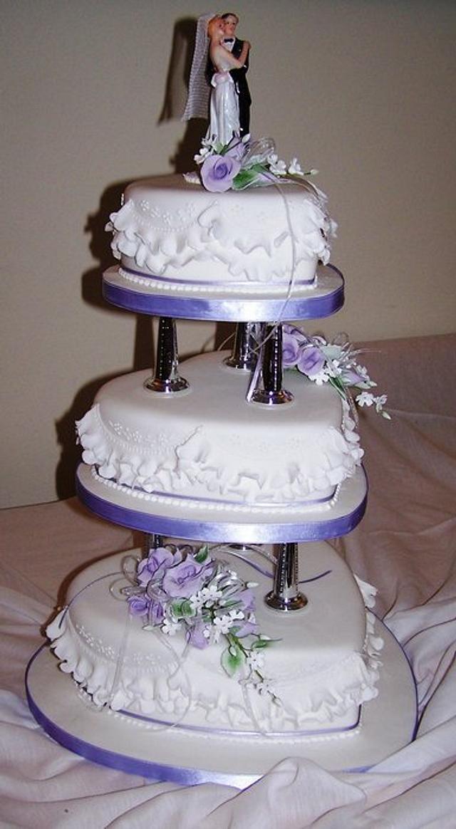 3 tier Traditional Wedding cake with garrett frills & sugar roses