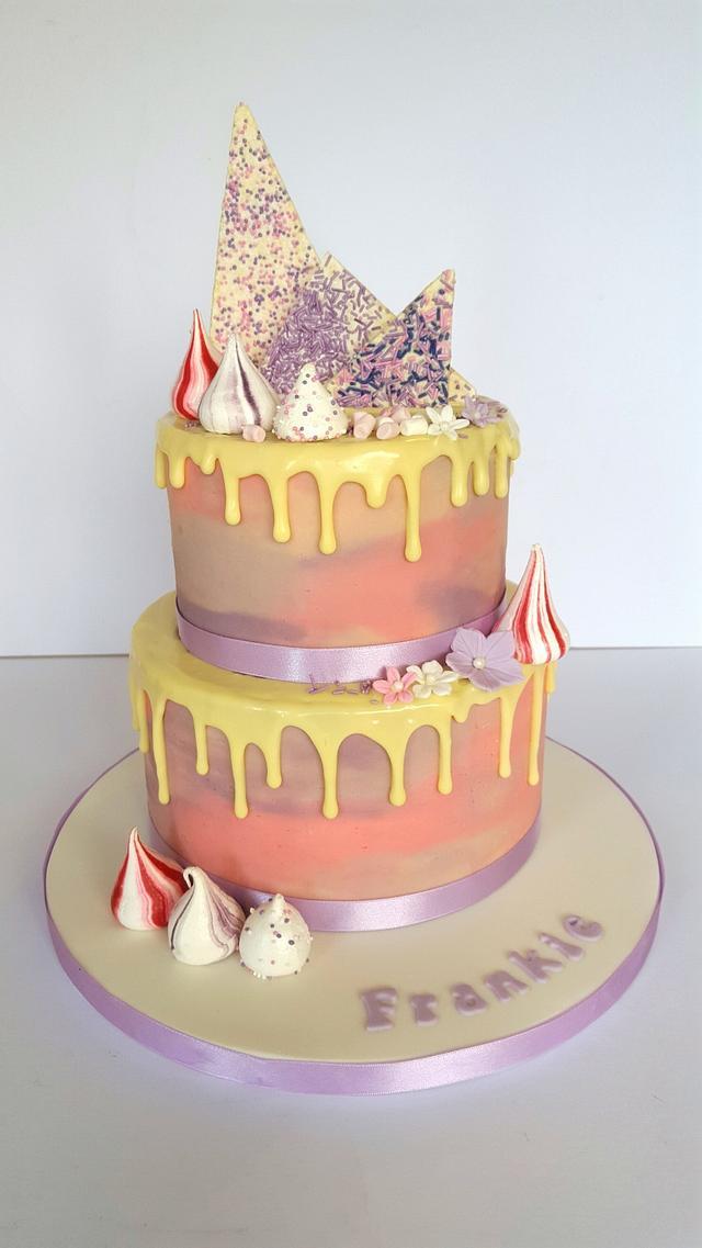 Pastel pink and purple drop cake.
