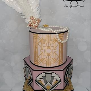 Art Deco cake with edible decoration and wafer paper feathers