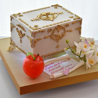 the casket cake with red apple