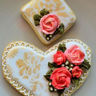 Heart with royal icing flowers and decoration.
