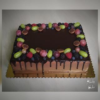 Chocolate birthday cake with fresh fruits