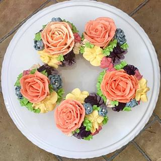 Hand piped flower cupcakes