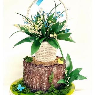 Lily of valley basket on the stump